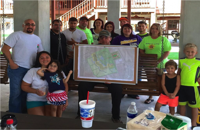 Chief Albert Naquin and community members with resettlement plan (Photo by Kristina Peterson)