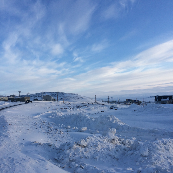 Arctic sky and road, Iqaluit, Nunavut (Photo by Dr. J. Paige MacDougall, Canadian Deafness and Training Institute)