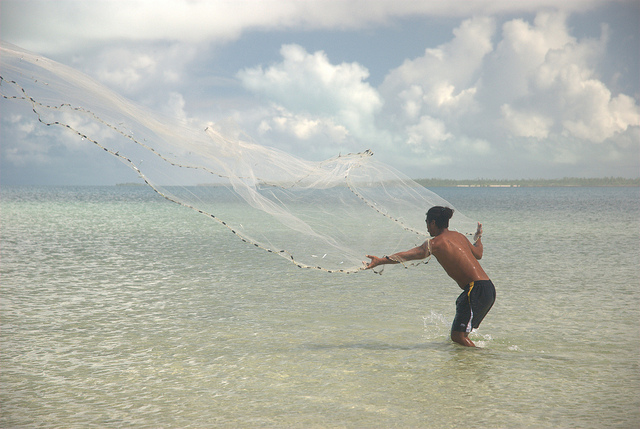 An artisanal net fisherman in a Kiribati lagoon. Australia is supporting several programmes in the Pacific to help protect fast depleting fish stocks.