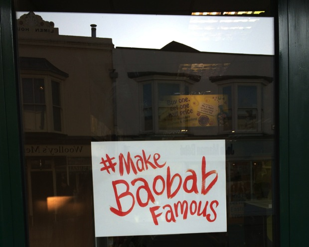 Sign on a UK main street, imploring passersby to help #MakeBaobabFamous (Photo credit: Amber Abrams)