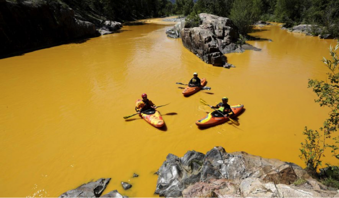 Figure 2: Kayakers on the Animas River in the wake of the Gold King Mine spill (© Jerry McBride, Durango Herald).